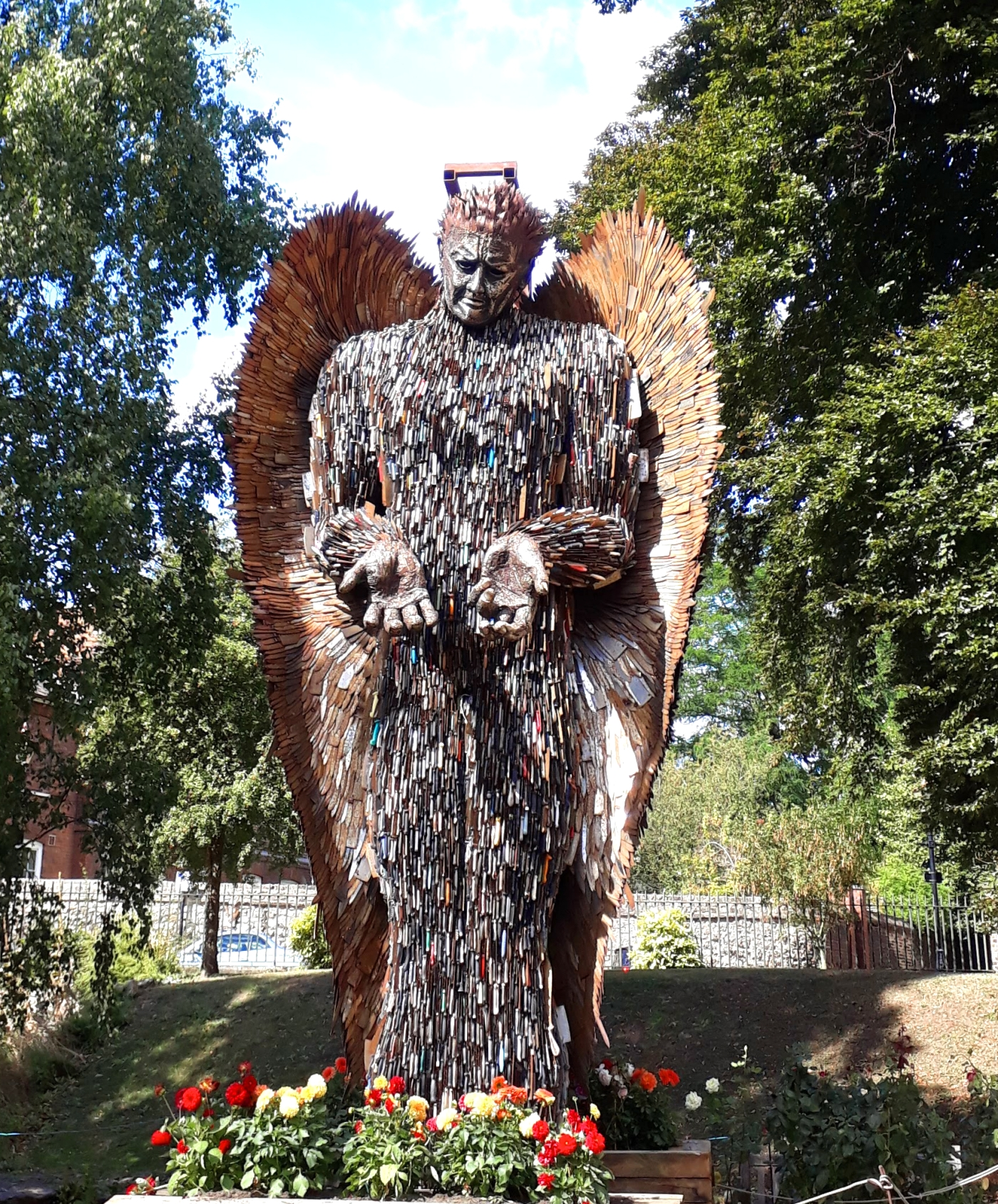 The knife angel standing among trees
